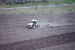 farm field preparation, plowing, discing, leveling